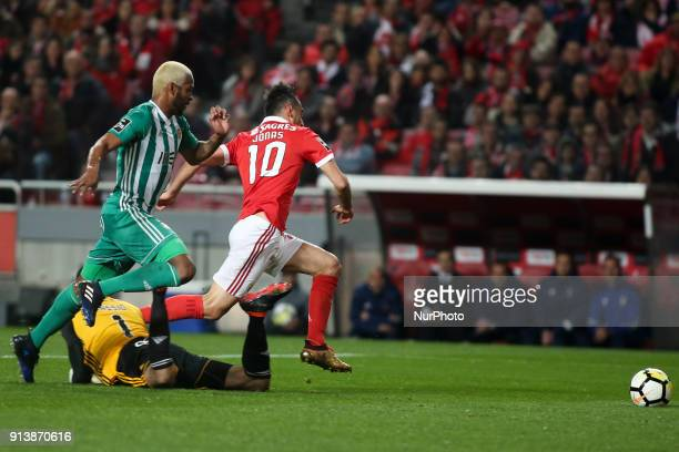 Benfica's forward Jonas ies with Rio Ave's defender Marcao and Rio Ave's goalkeeper Cassio during the Portuguese League football match between SL...