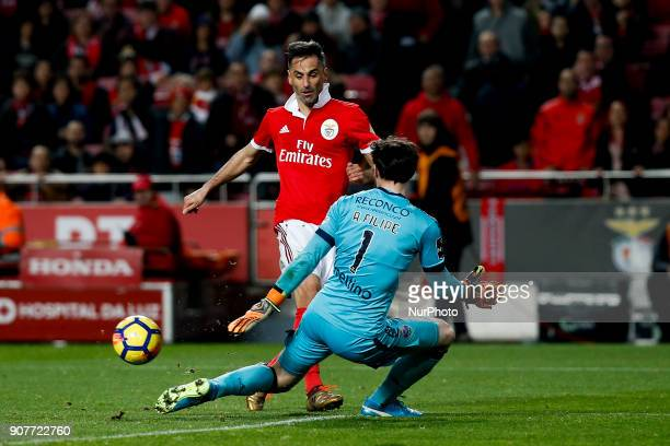 Benfica's forward Jonas vies for the ball with Chaves's goalkeeper Antonio Filipe during Primeira Liga 2017/18 match between SL Benfica vs GD Chaves...