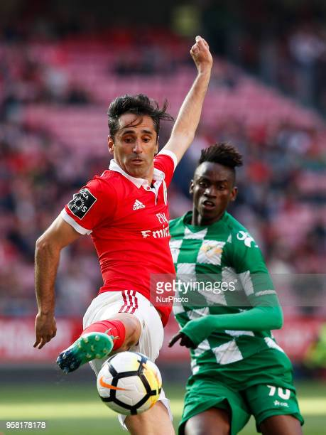 Benfica's forward Jonas vies for the ball with Moreirense's midfielder Alfa Semedo during the Portuguese League football match between SL Benfica and...