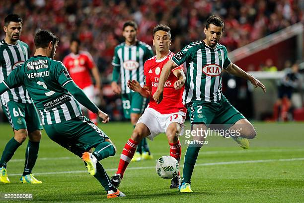 Benfica's forward Jonas vies for the ball with Setubal's defender Frederico Venancio and Setubal's defender Tiago Valente during the Portuguese...