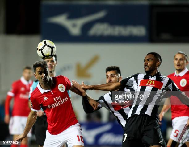 Benfica's forward Jonas vies with Portimonense's midfielder Dener during the Portuguese League football match between Portimonense SC and SL Benfica...