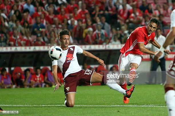 Benfica's forward Jonas vies with Torino's defender Antonio Barreca during the Eusebio Cup football match between SL Benfica and Torino FC at the Luz...