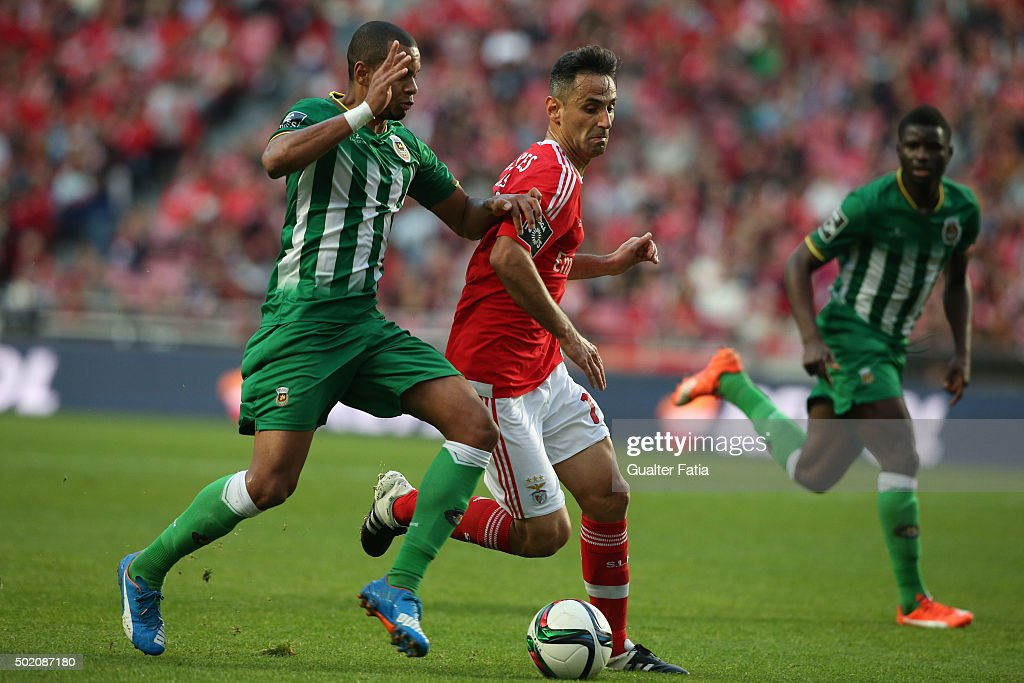SL Benfica's forward Jonas with Rio Ave FC's defender Edimar in action during the Primeira Liga match between SL Benfica and Rio Ave FC at Estadio da Luz on December 20, 2015 in Lisbon, Portugal.