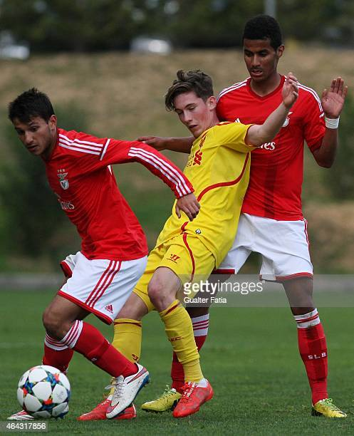 Benfica's forward Joo Carvalho and defender Isaac Fernandes with Liverpool FC's forward Harry Wilson in action during the UEFA Youth League match...