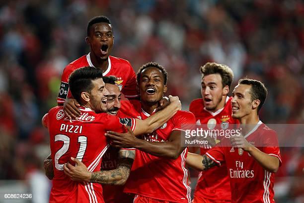 Benfica's forward Kostas Mitroglou celebrates his goal with Benfica's forward Pizzi Benfica's defender Nelson Semedo Benfica's forward Andre Carrillo...