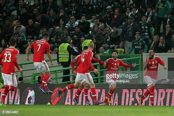 Benfica's forward Kostas Mitroglou celebrates scoring Benfica«s goal with his team during the match between Sporting CP and SL Benfica for the...