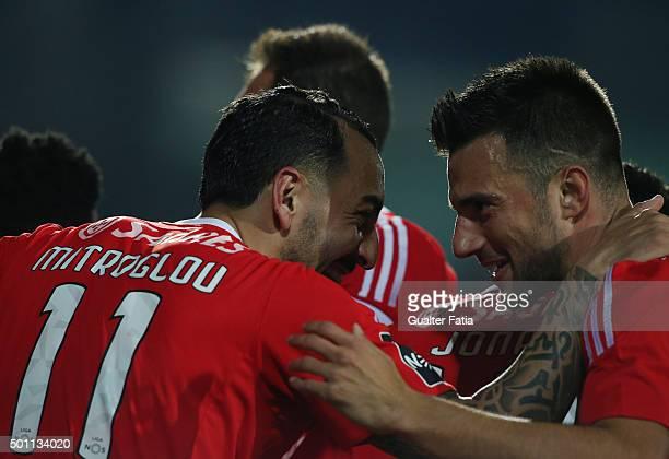 Benfica's forward Kostas Mitroglou celebrates with teammate Andreas Samaris after scoring a goal during the Primeira Liga match between Vitoria...