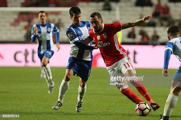 Benficas forward Kostas Mitroglou from Greece and Vizelas midfielder Diogo Lamelas from Portugal during the Portuguese Cup 2016/17 match between SL...