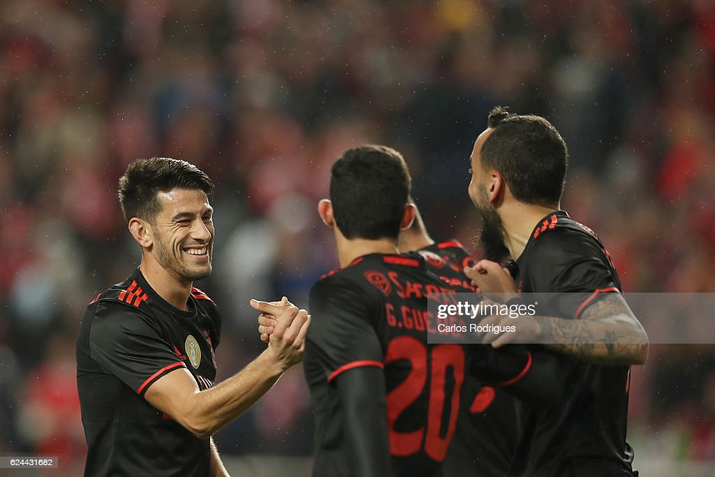 Benfica's forward Kostas Mitroglou from Greece celebrates scoring Benfica«s fourth goal (R) with Benfica's forward Pizzi from Portugal (L) and Benfica's forward Goncalo Guedes from Portugal (C) during the SL Benfica v CS Maritimo - Portuguese Cup round 4 match at Estadio da Luz on November 19, 2016 in Lisbon, Portugal.