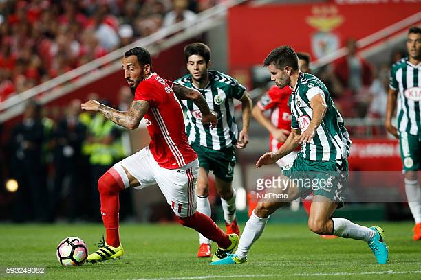 Benfica's forward Kostas Mitroglou vies for the ball with Setubal's defender Frederico Venancio during the Portuguese League football match between...