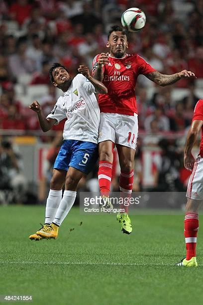 Benfica's forward Kostas Mitroglou vies with Estoril's defender Anderson Luis during the match between SL Benfica and Estoril Praia at Estadio da Luz...