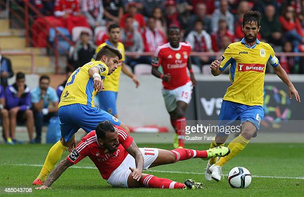 Benfica's forward Mitroglou with FC Arouca's defender Hugo Basto in action during the Primeira Liga match between FC Arouca and SL Benfica at Estadio...