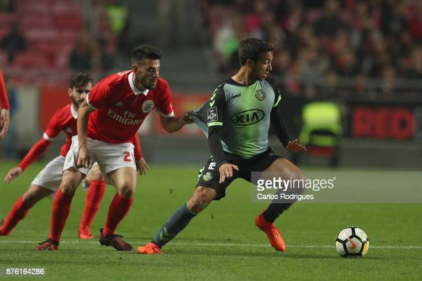 Benfica's forward Pizzi from Portugal pulls Setubal's midfielder Fabio Pacheco from Portugal shirt during the match between SL Benfica and FC Vitoria...