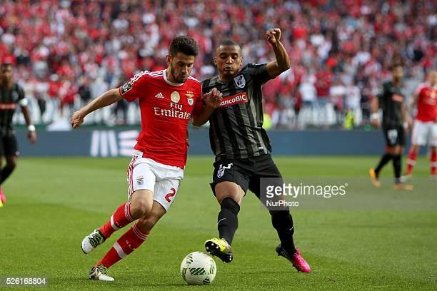 Benfica's forward Pizzi vies with Guimaraes's defender Dalbert Estevo during the Portuguese League football match SL Benfica vs Vitoria Guimaraes SC...