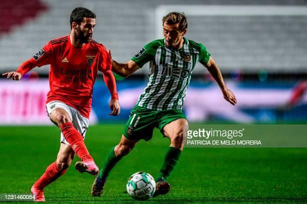 Benfica's forward Rafa da Silva challenges Rio Ave's Portuguese midfielder Francisco Geraldes during the Portuguese league football match between SL...