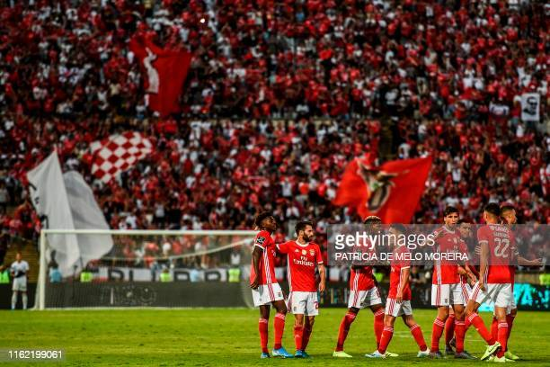 Benfica's forward Rafa Silva celebrates with teammates after scoring a goal during the Portuguese League football match between Belenenses and...