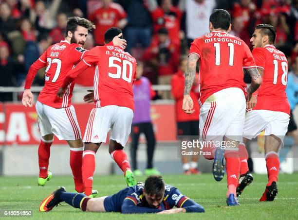 Benfica's forward Rafa Silva celebrates with teammates after scoring a goal during the Primeira Liga match between SL Benfica and GD Chaves at...