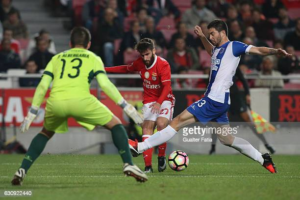 Benfica's forward Rafa Silva with Vizela's defender Joao Sousa from Portugal and Vizela's goalkeeper Pedro Albergaria from Portugal in action during...