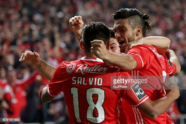 Benfica's forward Raul Jimenez celebrates with teammates after scoring during the Portuguese League football match SL Benfica vs Sporting CP at the...