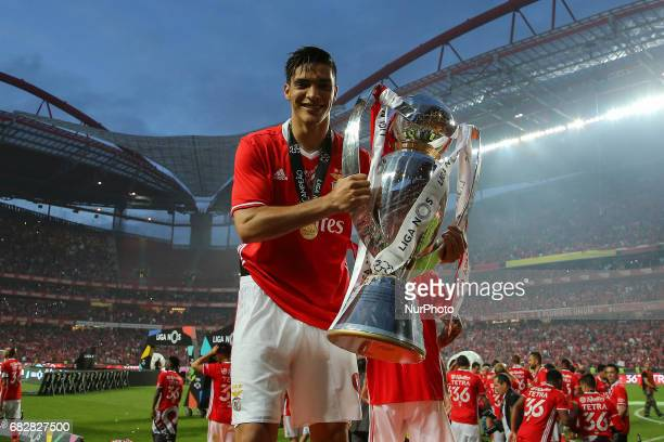 Benfica's forward Raul Jimenez from Mexico celebrating the tetra title with his team mates after the match between SL Benfica and Vitoria SC for the...