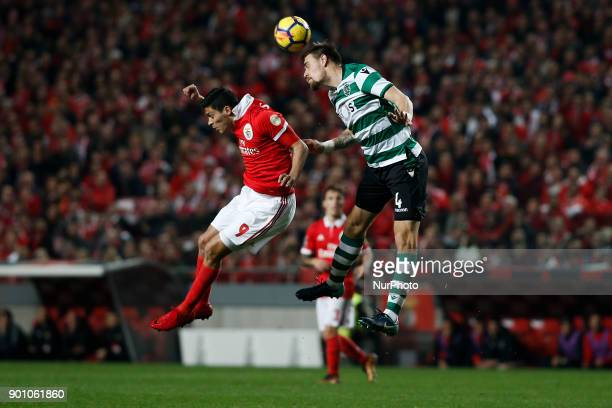 Benfica's forward Raul Jimenez vies for the ball with Sporting's defender Sebastian Coates during Primeira Liga 2017/18 match between SL Benfica vs...