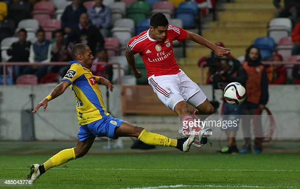 Benfica's forward Raul Jimenez with FC Arouca's defender Jailson in action during the Primeira Liga match between FC Arouca and SL Benfica at Estadio...