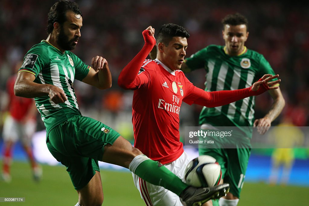 SL Benfica's forward Raul Jimenez with Rio Ave FC's defender Marcelo in action during the Primeira Liga match between SL Benfica and Rio Ave FC at Estadio da Luz on December 20, 2015 in Lisbon, Portugal.