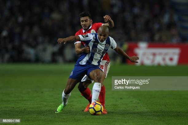 Benfica's forward Toto Salvio from Argentina tackles FC PortoÕs forward Yacine Brahimi from Algeria during the FC Porto v SL Benfica Primeira Liga...