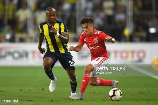 Benfica's Franco Cevri vies for the ball with Fenerbahce's Andre Ayew during UEFA Champions league third round second leg qualifying football match...