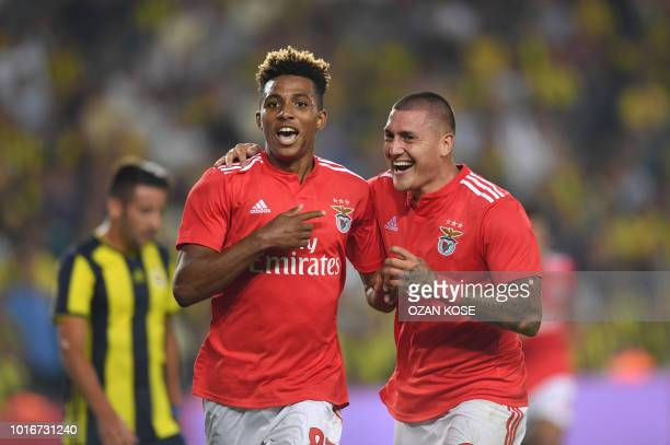 Benfica's Gebson Fernandes celebrates with his team mates after scoring a goal during UEFA Champions league third round second leg qualifying...
