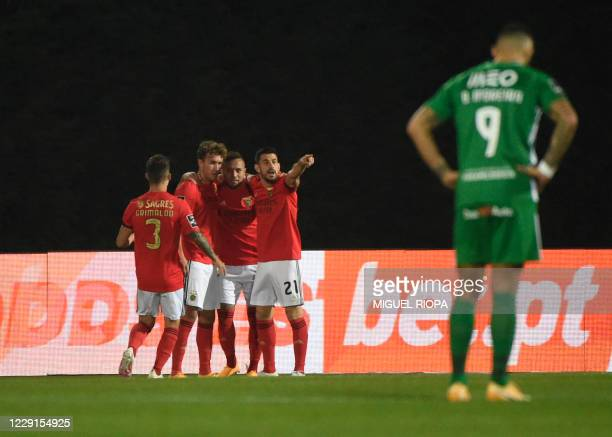 Benfica's German forward Luca Waldschmidt celebrates with teammates after scoring a goal during the Portuguese League football match between Rio Ave...