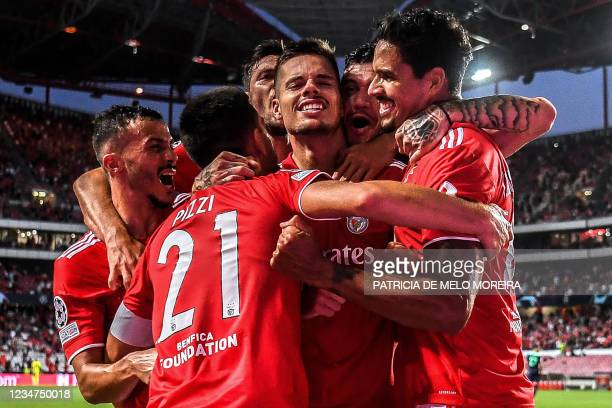 Benfica's German midfielder Julian Weigl celebrates with teammates scoring Benfica's second goal during the UEFA Champions League play-off first leg...