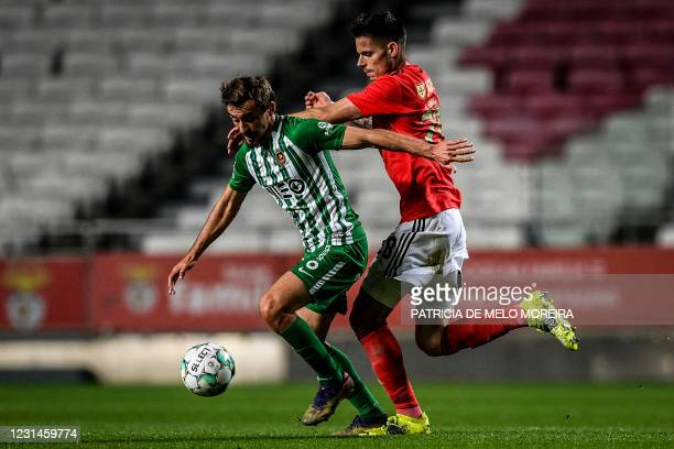 Benfica's German midfielder Julian Weigl challenges Rio Ave's Portuguese midfielder Francisco Geraldes during the Portuguese league football match...