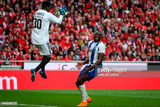 Benfica's goalkeeper Bruno Varela vies with Porto's Malian forward Moussa Marega during the Portuguese league footbal match between SL Benfica and FC...