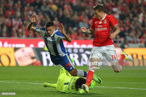 Benficas goalkeeper Ederson Moraes from Brazil and FC Portos forward Soares from Brazil during the Premier League 2016/17 match between SL Benfica v...