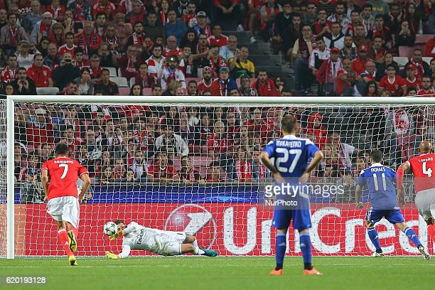 Benficas goalkeeper Ederson Moraes from Brazil saves a penalty kick during UEFA Champions League Group B match between SL Benfica and Dynamo Kyiv at...