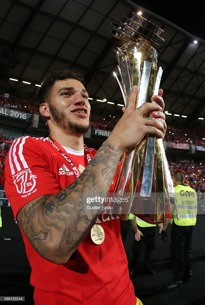 SL Benfica's goalkeeper from Brazil Ederson celebrates with trophy after winning the Portuguese League Cup Title at the end of the Taca CTT Final match between SL Benfica and CS Maritimo at Estadio Efapel Cidade de Coimbra on May 20, 2016 in Coimbra, Portugal.