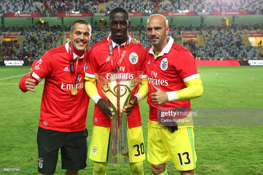 Benfica's goalkeeper Julio Cesar from Brasil (L), Benfica's goalkeeper Bruno Varela from Portugal (C) and Benfica's goalkeeper Paulo Lopes from Portugal (R) with Portuguese Super Cup trophy after the match between SL Benfica and VSC Guimaraes at Estadio Municipal de Aveiro on August 05, 2017 in Lisbon, Portugal.