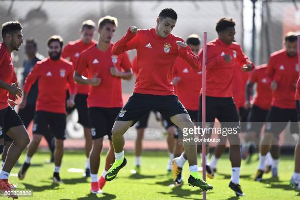 Benfica's Greek forward Konstantinos Mitroglou attends a training session with teammates at the club's training ground in Seixal in the outskirts of...