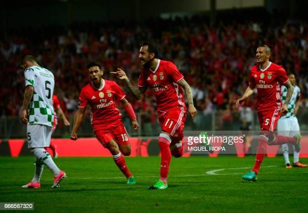 Benfica's Greek forward Konstantinos Mitroglou celebrates after scoring a goal during the Portuguese league football match Moreirense FC vs SL...