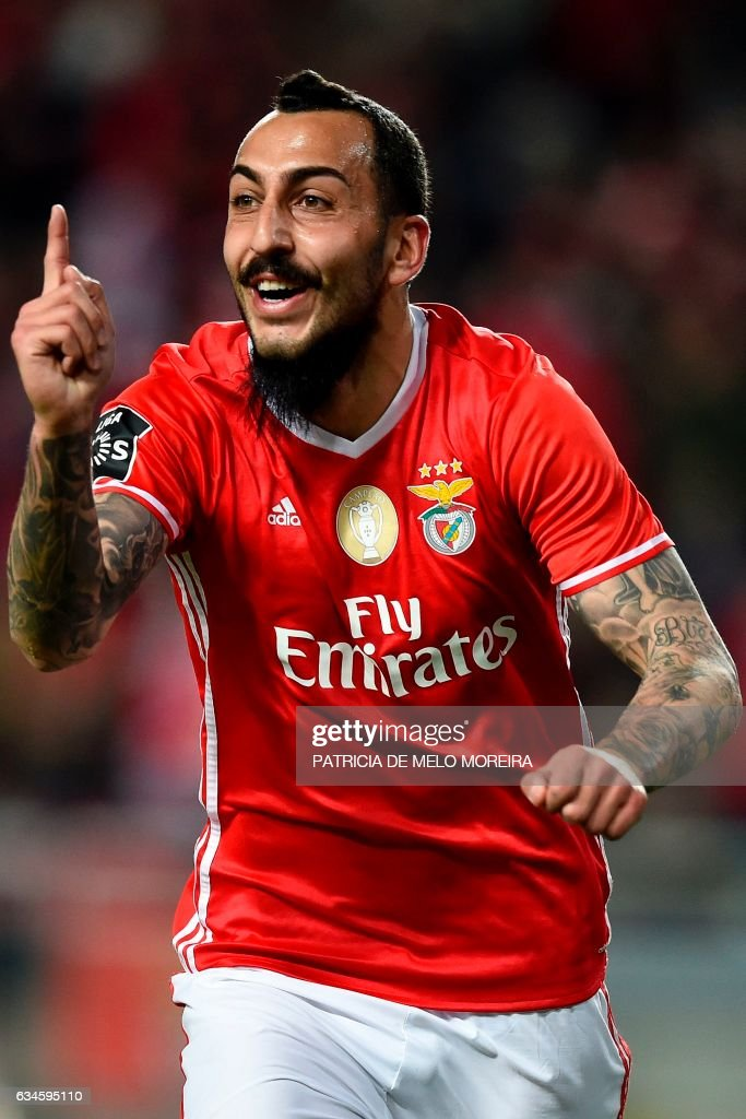 Benfica's Greek forward Konstantinos Mitroglou celebrates after scoring during the Portuguese league football match SL Benfica vs FC Arouca at the Luz stadium in Lisbon on February 10, 2017. /