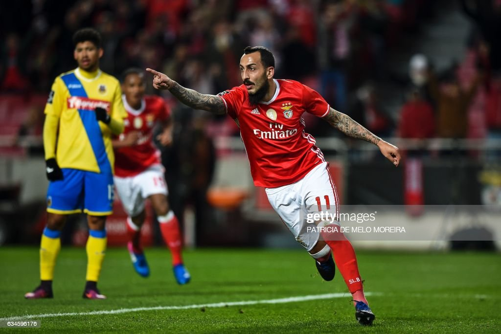 Benfica's Greek forward Konstantinos Mitroglou celebrates after scoring during the Portuguese league football match SL Benfica vs FC Arouca at the Luz stadium in Lisbon on February 10, 2017. / AFP / PATRICIA