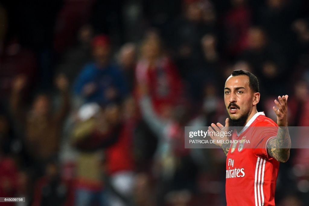 Benfica's Greek forward Konstantinos Mitroglou celebrates after scoring during the Portuguese league football match SL Benfica vs GD Chaves at the Luz stadium in Lisbon on February 24, 2017. / AFP / PATRICIA