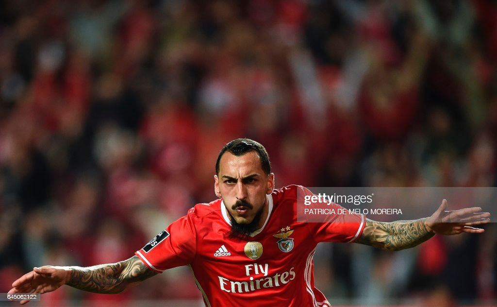 Benfica's Greek forward Konstantinos Mitroglou celebrates after scoring during the Portuguese league football match SL Benfica vs GD Chaves at the Luz stadium in Lisbon on February 24, 2017. /