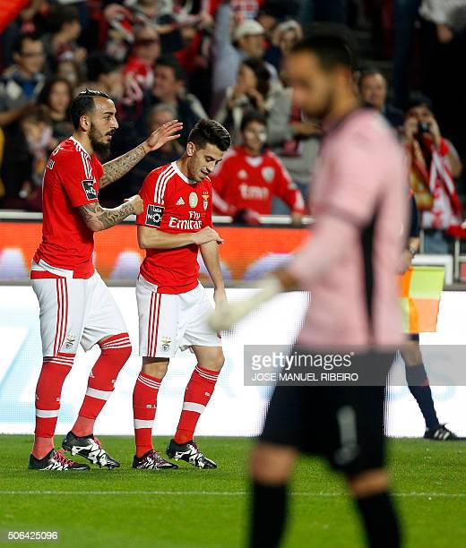 Benfica's Greek forward Konstantinos Mitroglou celebrates his goal with mate midfielder Pizzi during the Portuguese league football match SL Benfica...