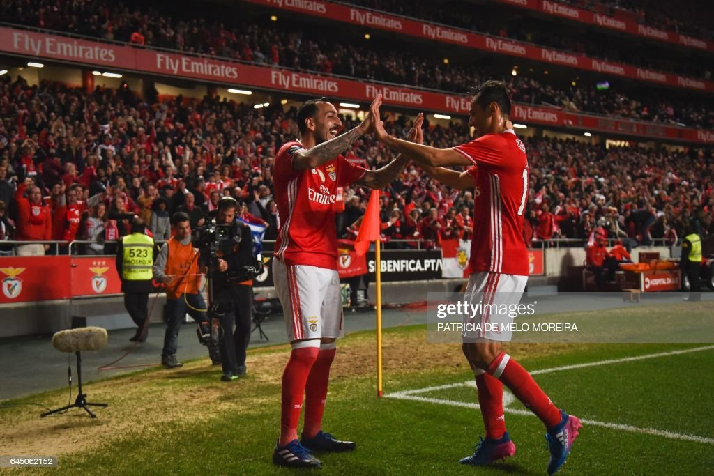 Benfica's Greek forward Konstantinos Mitroglou (L) celebrates with his teammate Benfica's Brazilian forward Jonas Oliveira (R) after scoring during the Portuguese league football match SL Benfica vs GD Chaves at the Luz stadium in Lisbon on February 24, 2017. / AFP / PATRICIA