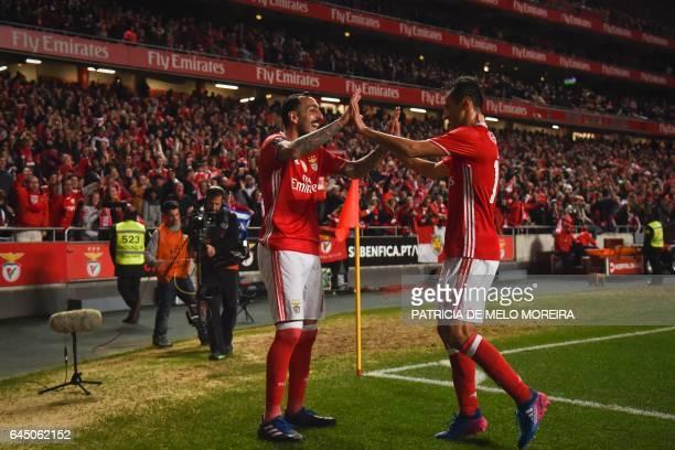 Benfica's Greek forward Konstantinos Mitroglou celebrates with his teammate Benfica's Brazilian forward Jonas Oliveira after scoring during the...