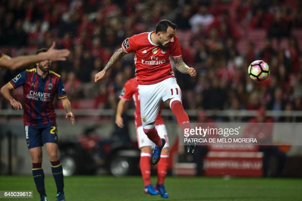 Benfica's Greek forward Konstantinos Mitroglou heads the ball and scores during the Portuguese league football match SL Benfica vs GD Chaves at the...
