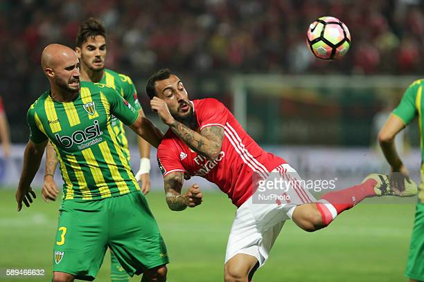 Benfica's Greek forward Kostas Mitroglou in action with Tondela's Portuguese defender Joao Pica during the Premier League 2016/17 match between CD...