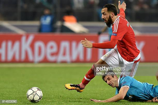 Benfica's Greek forward Kostas Mitroglou vies for the ball with Zenit's Brazilian midfielder Mauricio during the secondleg round of 16 UEFA Champions...